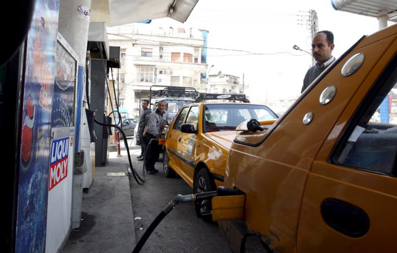 Syria's capital Damascus is experiencing a fuel crisis, with residents lining up for hours at the pump after a highway used by fuel tankers was blocked by fighting. (AFP File Photo)