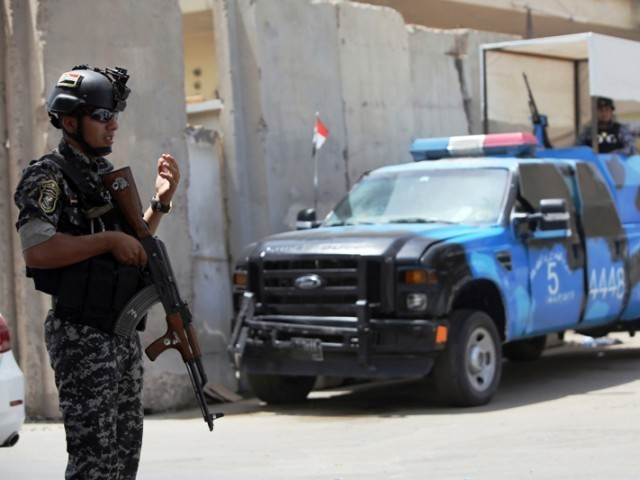 Iraqi policemen man a checkpoint in the capital Baghdad on June 12, 2014, as rebels and anti-government fighters have spearheaded a major offensive that overrun all of Nineveh province. AFP