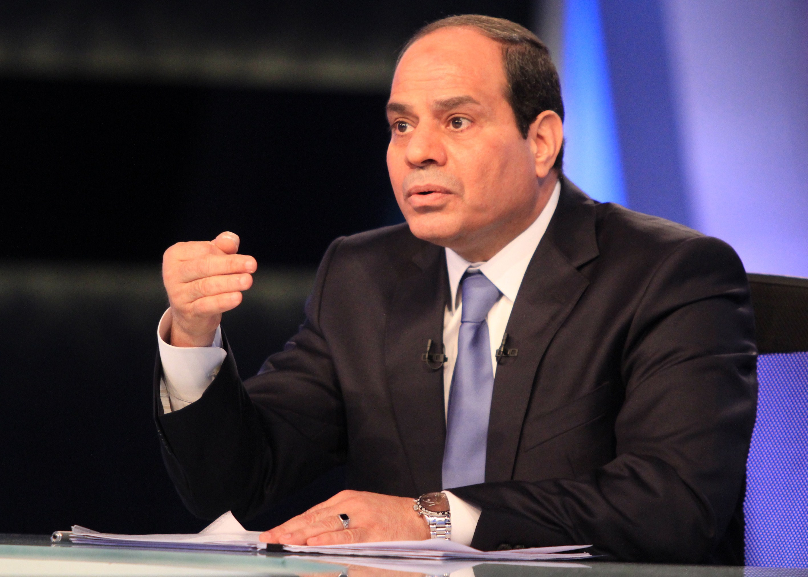 Egypt's ex-army chief and leading presidential candidate Abdel Fattah al-Sisi gives his first television interview since announcing his candidacy in Cairo on May 4, 2014. Sisi is expected to win the May 26-27 election easily riding on a wave of popularity after he ousted in July Mohamed Morsi, Egypt's first freely elected president. The 59-year-old retired field marshal, dressed in a suit and appearing composed and often smiling in what was a pre-recorded interview, is seen by supporters as a strong leader who can restore stability, but his opponents fear that might come at the cost of freedoms sought in the pro-democracy uprising three years ago.  (AFP PHOTO/STR)