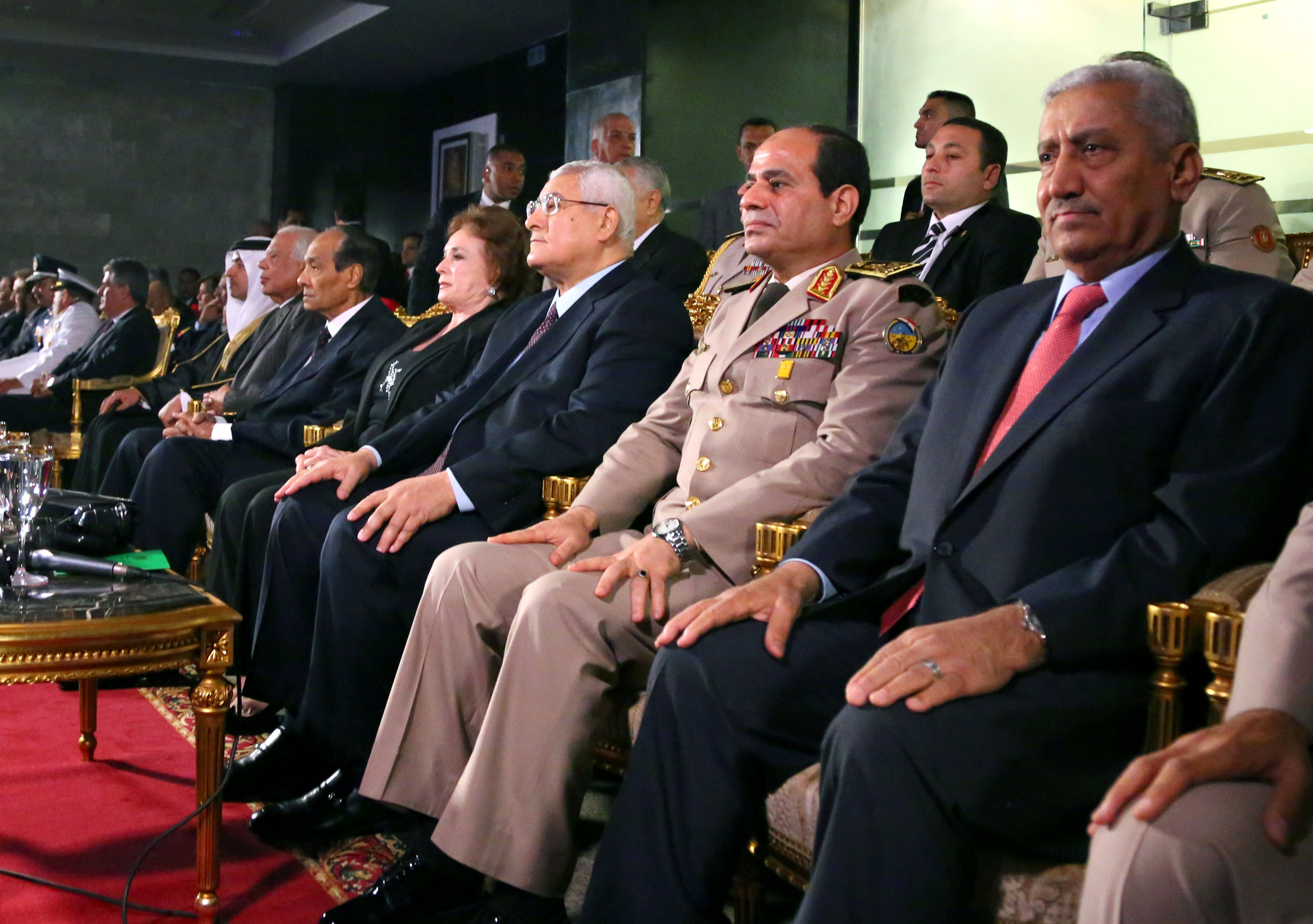A handout picture released by the Egyptian Presidency shows Egypt's interim president Adly Mansour (3R) and General Abdel Fattah al-Sisi (2R) attending a ceremony to mark the anniversary of the 1973 Arab-Israeli war, on October 6, 2013 in the capital, Cairo. (AFP Photo)