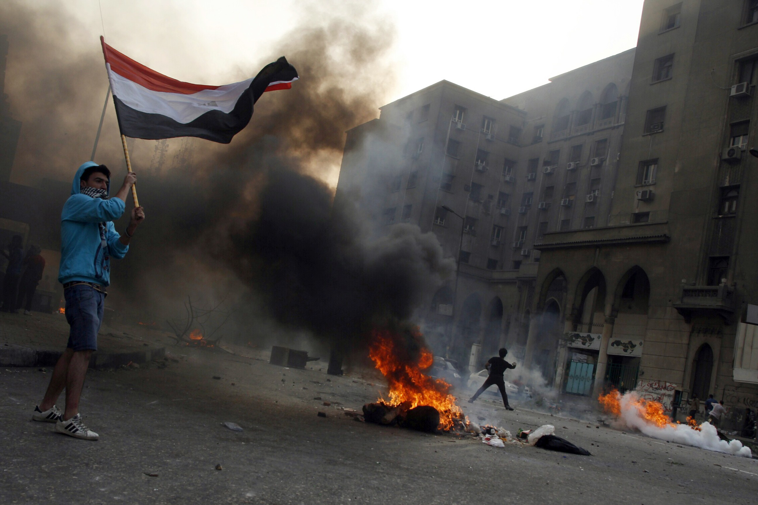 Tires burn as Egyptian Muslim brotherhood and supporters of ousted president Mohamed Morsi take part in clashes with riot police along Ramsis street in downtown Cairo, on October 6, 2013. (AFP PHOTO / MOHAMMED ABDEL MONEIM)
