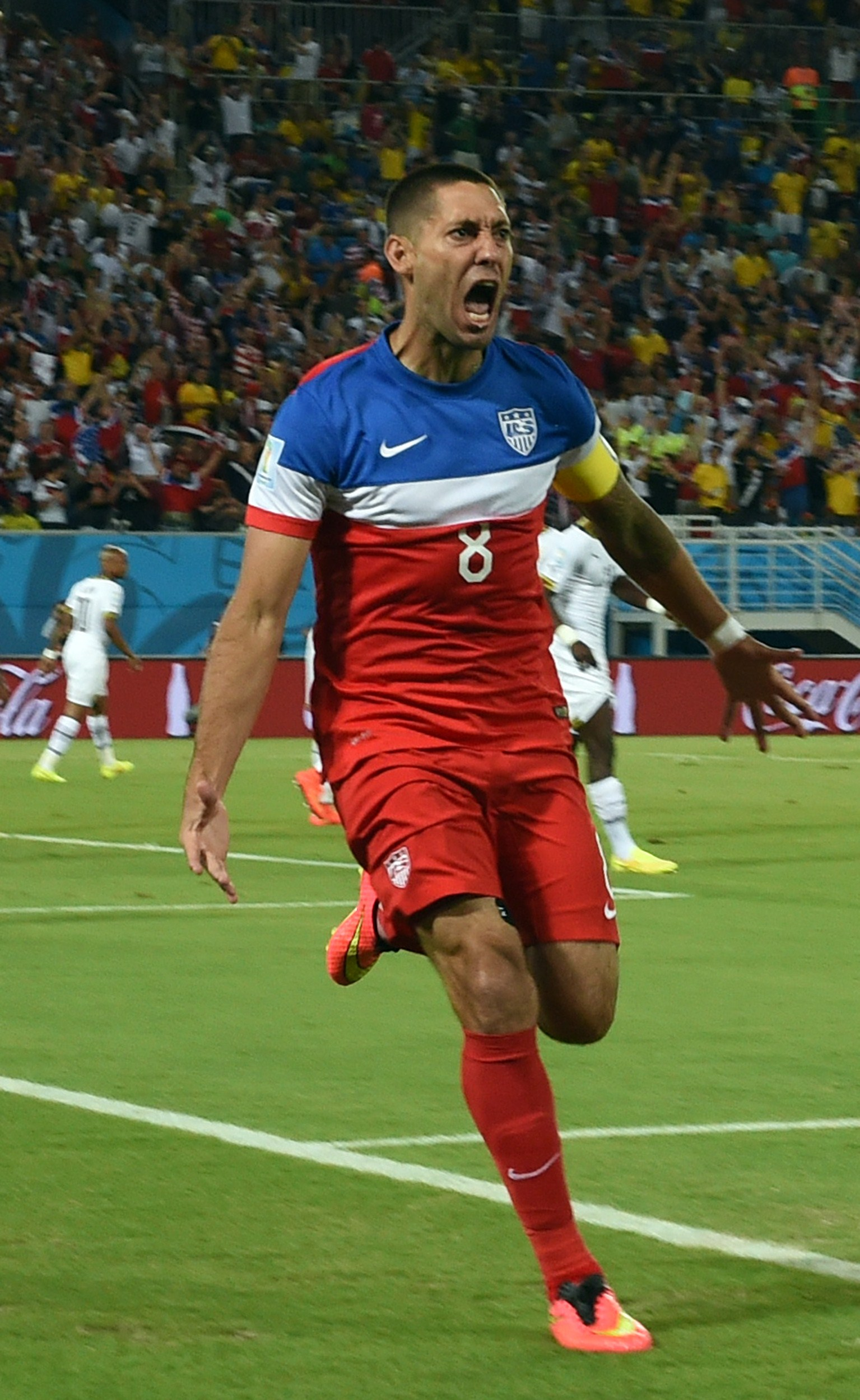 US forward Clint Dempsey celebrates after scoring during a Group G football match between Ghana and US at the Dunas Arena in Natal during the 2014 FIFA World Cup on June 16, 2014.   (AFP PHOTO / CARL DE SOUZA)