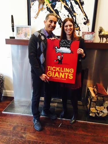 "Bassem Youssef and director Sara Taksler stand with the poster for ""Tickling Giants"" (Photo from Twitter)"