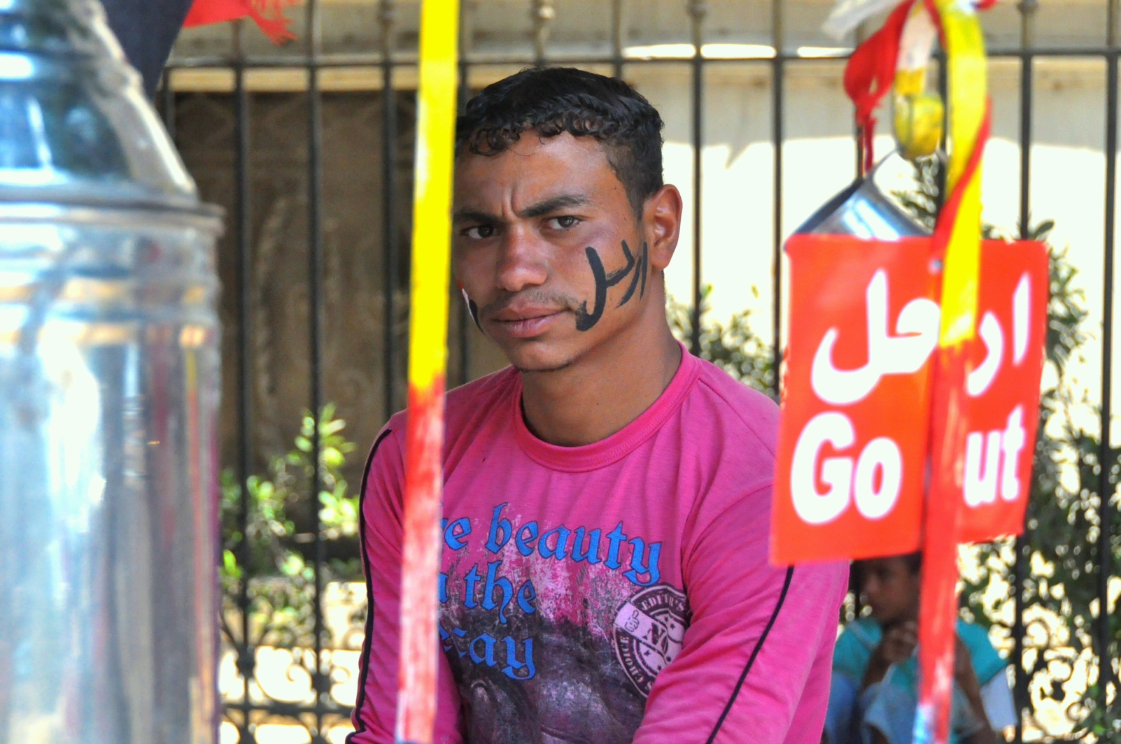 Vendor in Tahrir Square has decorated his cheeks with the word Erhal, Leave 1 July (Photo by Aaron T. Rose)