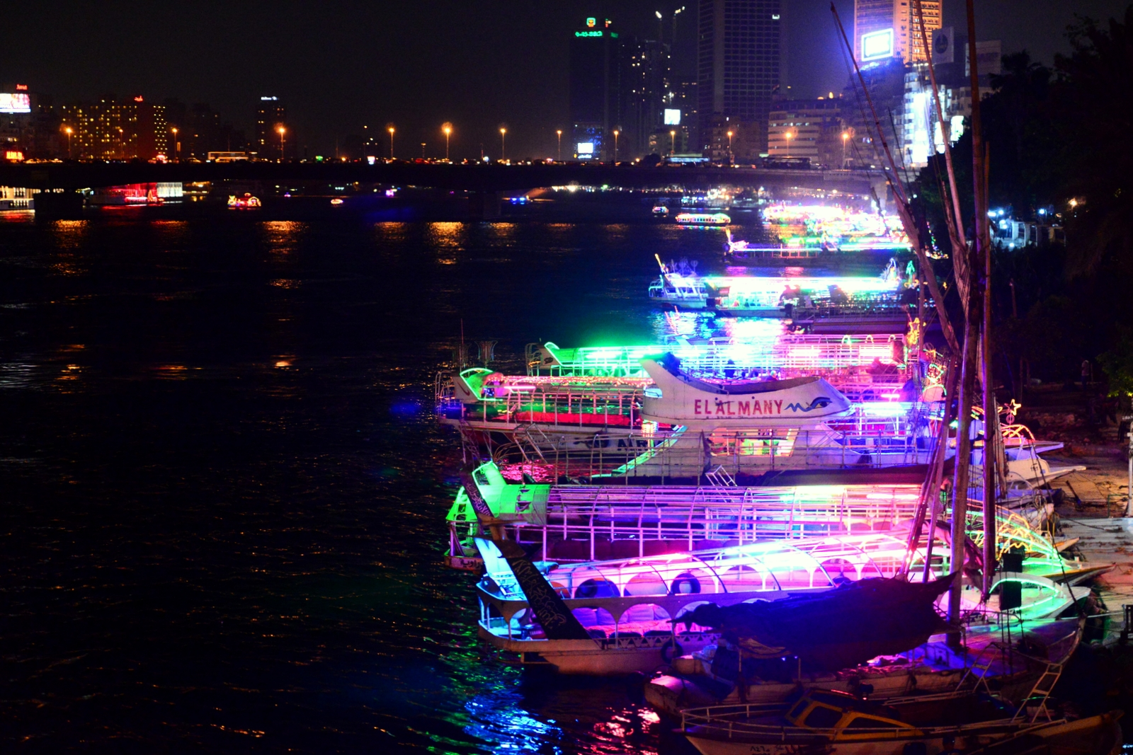 Fluorescent colours are used to light up the small boats and entice customers to come on board. (Photo by Aaron T. Rose)