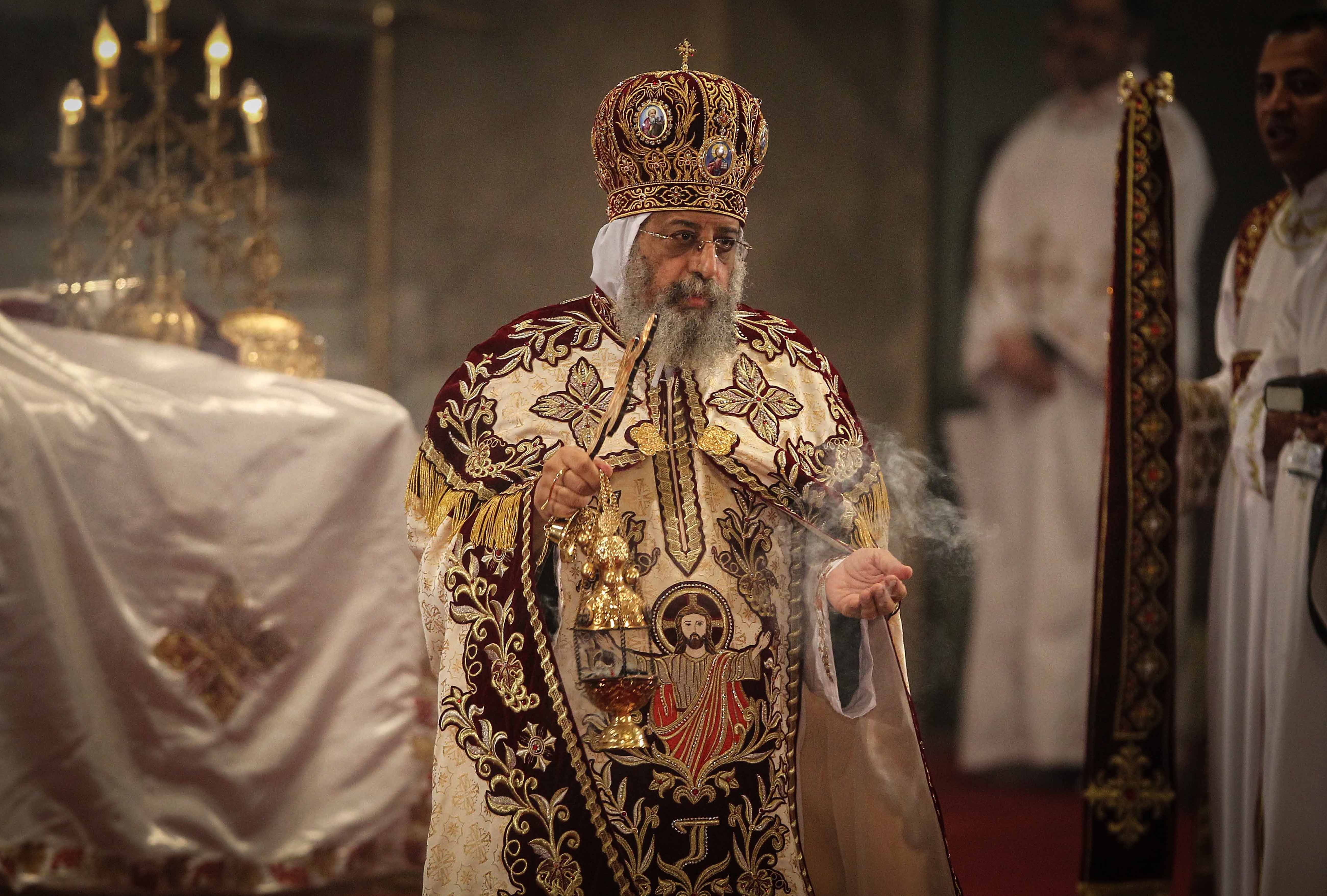 Pope Tawadros II, leader of Egypt's Coptic Church, leads an Easter service late on April 19, 2014 at the Cathedral of Abbasiya in Cairo AFP PHOTO/MOHAMED EL-SHAHED