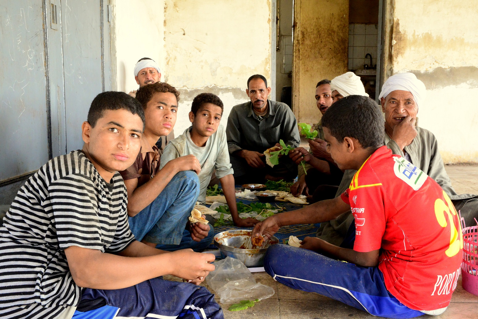 The families subsist on simple Egyptian foods like fuul and arugula, which they are happy to share with passersby (Photo by Aaron T. Rose)