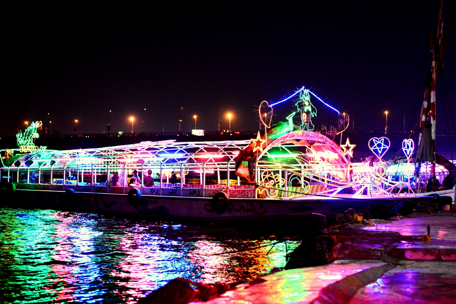 Hearts, stars and teddybears are but a few of the neonlight decorations of the boats. (Photo by Aaron T. Rose)