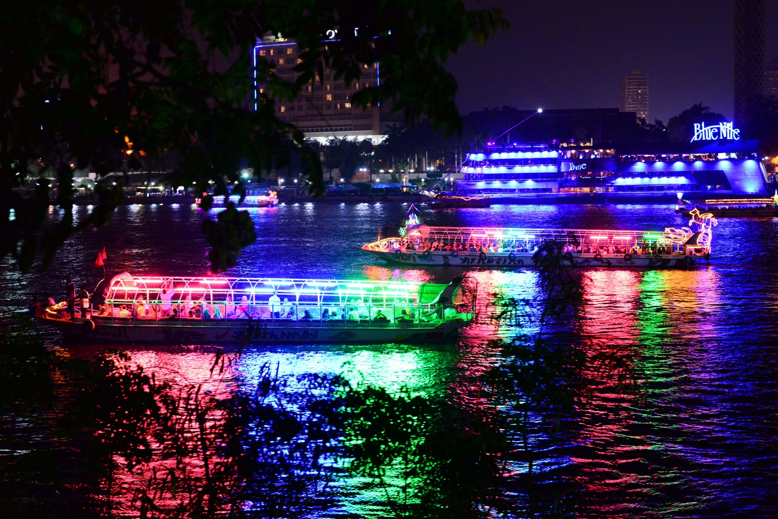 Green, blue and pink reflections turn the Nile into a riot of colours. (Photo by Aaron T. Rose)