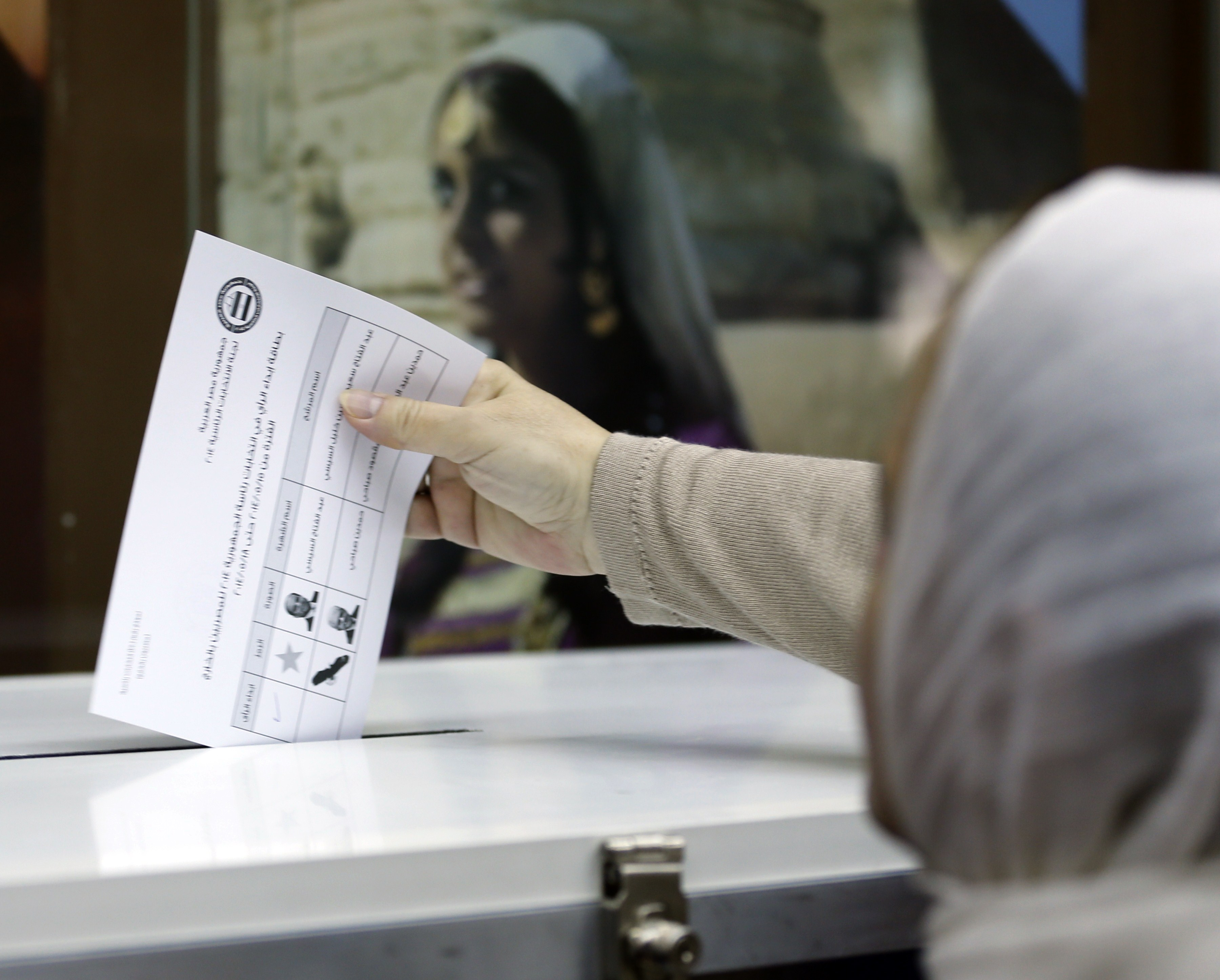 An Egyptian national residing in the United Arab Emirates casts her vote the Egyptian embassy in Dubai, on May 15, 2014.  Ex-army chief and leading presidential candidate Abdel Fattah al-Sisi is expected to win the May 26-27 election against his only rival, leftist Hamdeen Sabbahi, amid calls for a strong leader who can restore stability following the ousting of elected Islamist president Mohamed Morsi in July.    (AFP PHOTO/KARIM SAHIB)
