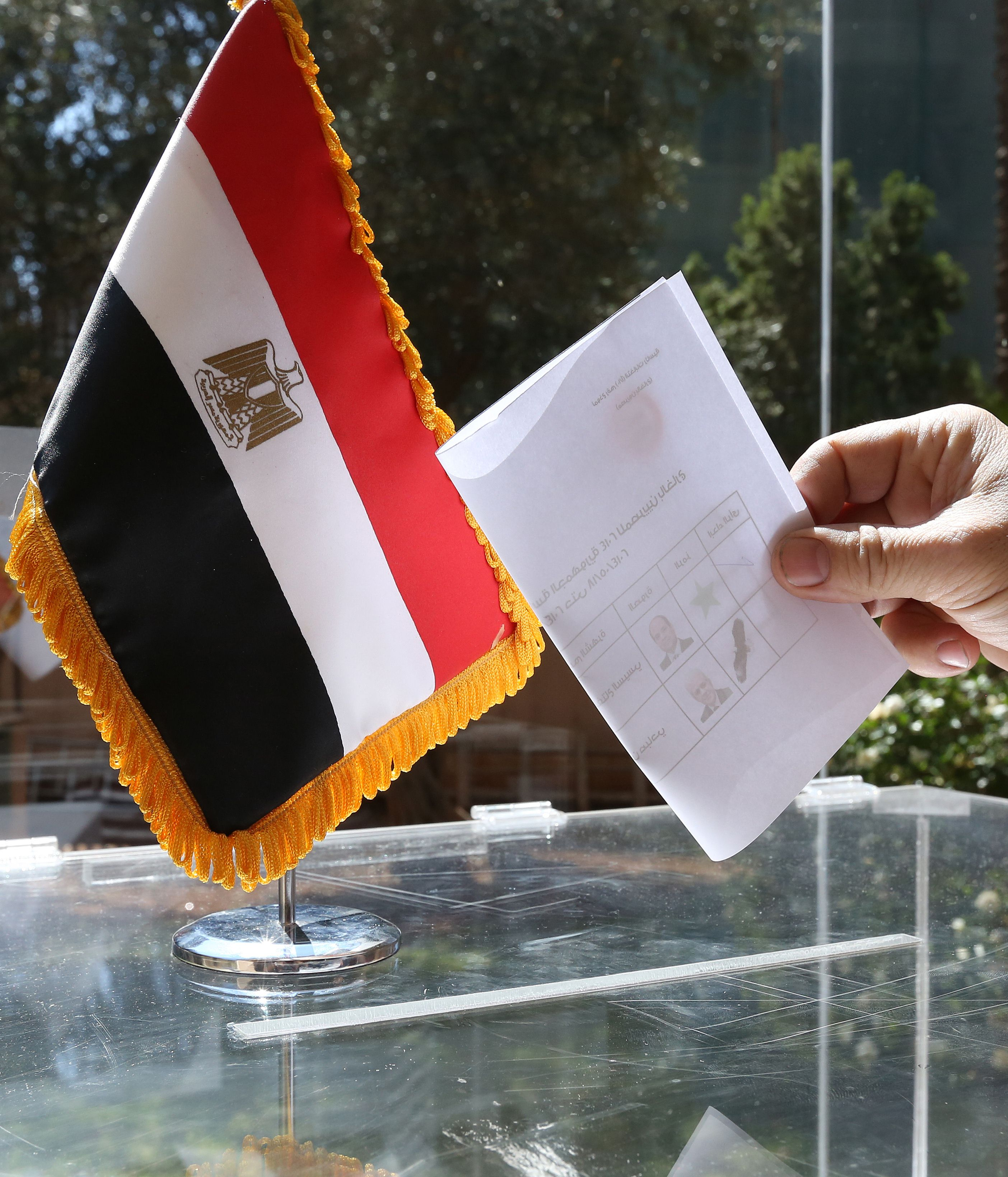 An Egyptian national residing in Lebanon casts his vote in his country's presidential elections at a polling station at the Egyptian embassy in Beirut on May 15, 2014. Egyptian expatriates around the world headed to the polls, casting the first votes to name a successor to deposed Islamist President Mohamed Morsi. (AFP PHOTO / ANWAR AMRO)