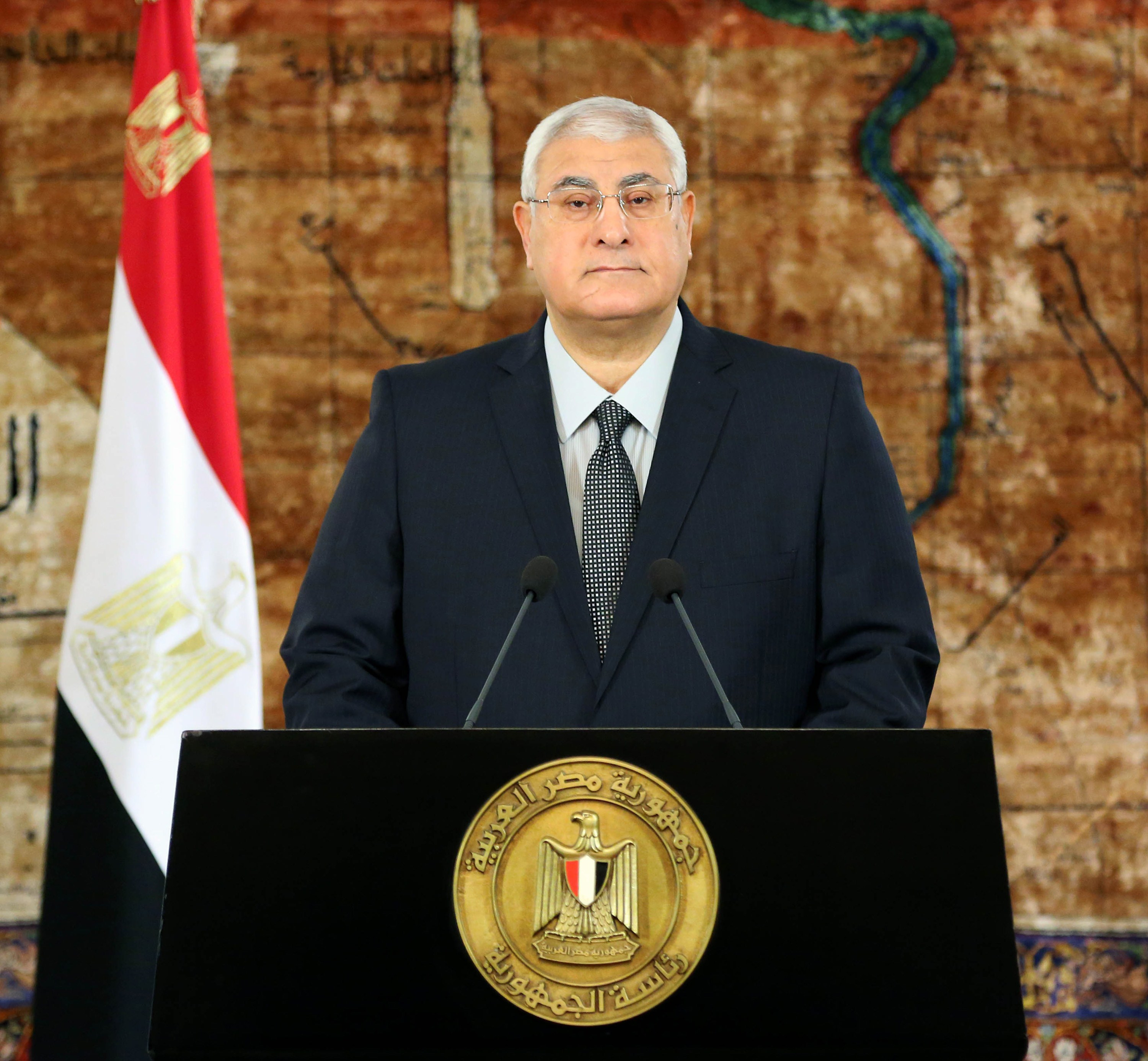 In this handout picture taken and released by the Egyptian Presidency,  Egypt's interim president Adly Mansour addresses the nation in Cairo on May 25, 2014, calling for people to vote in the upcoming Presidential election. Egyptians will vote on May 26 and May 27 in a presidential election and Army chief Abdel Fattah al-Sisi , who overthrew President Mohamed Morsi 11 months ago, is seen by many as the front runner.   (AFP PHOTO/ Egyptian Presidency)