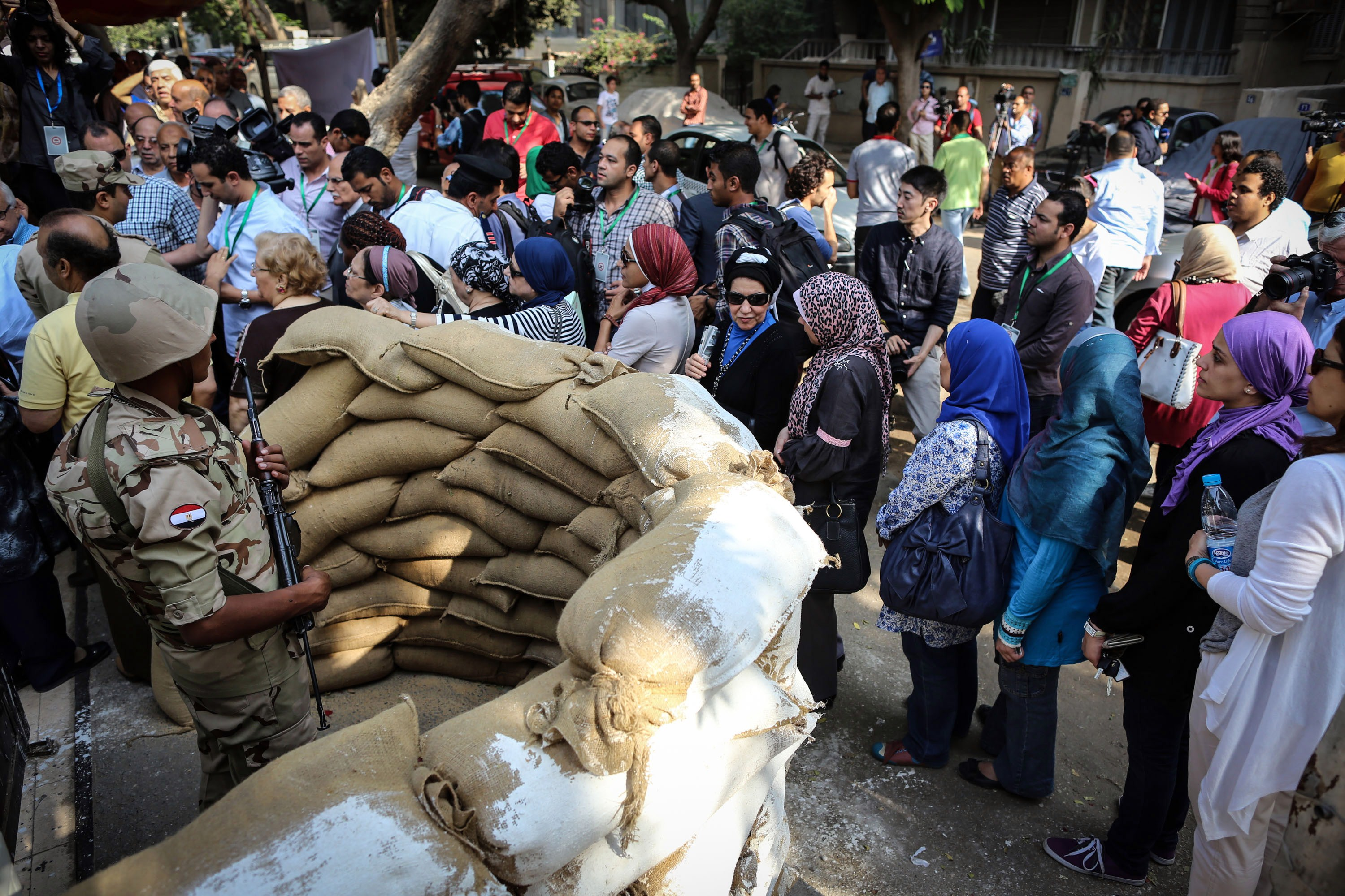 Egyptians queue outside a polling station in the capital Cairo on May 26, 2014. Egyptians voted for a new president, with the ex-army chief who overthrew the country's first democratically elected leader and crushed his Islamist movement expected to win in a landslide.  (AFP PHOTO/MOHAMED EL-SHAHED)