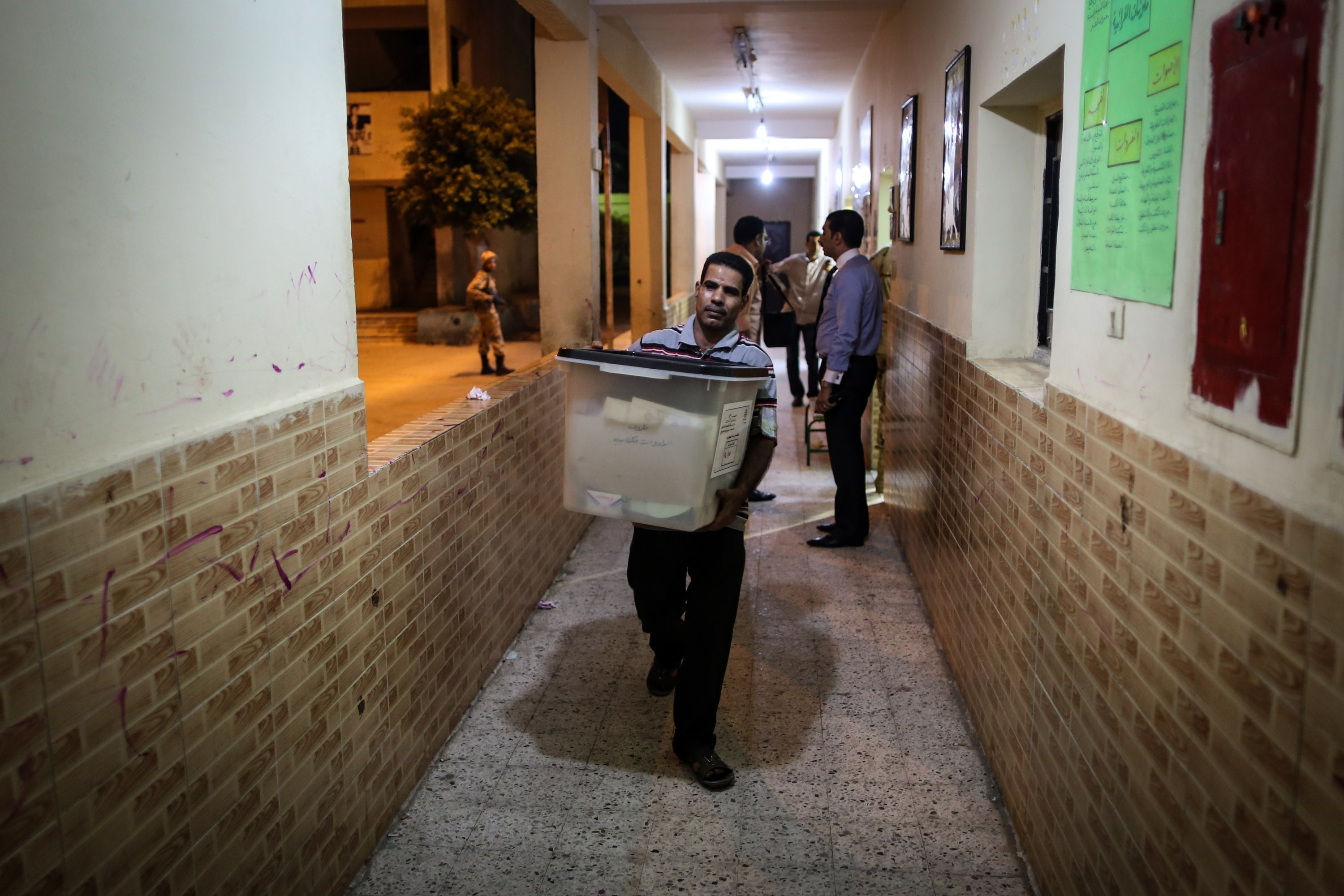 An Egyptian man carries a ballot box after a polling station closed at the end of the first day of the two-day election for a new president in the capital Cairo on May 26, 2014. Egyptians begin voting in a new presidential election which Sisi, who ousted the elected Islamist leader, is expected to easily win amid calls for stability and economic recovery.   (AFP PHOTO/MOHAMED EL-SHAHED)