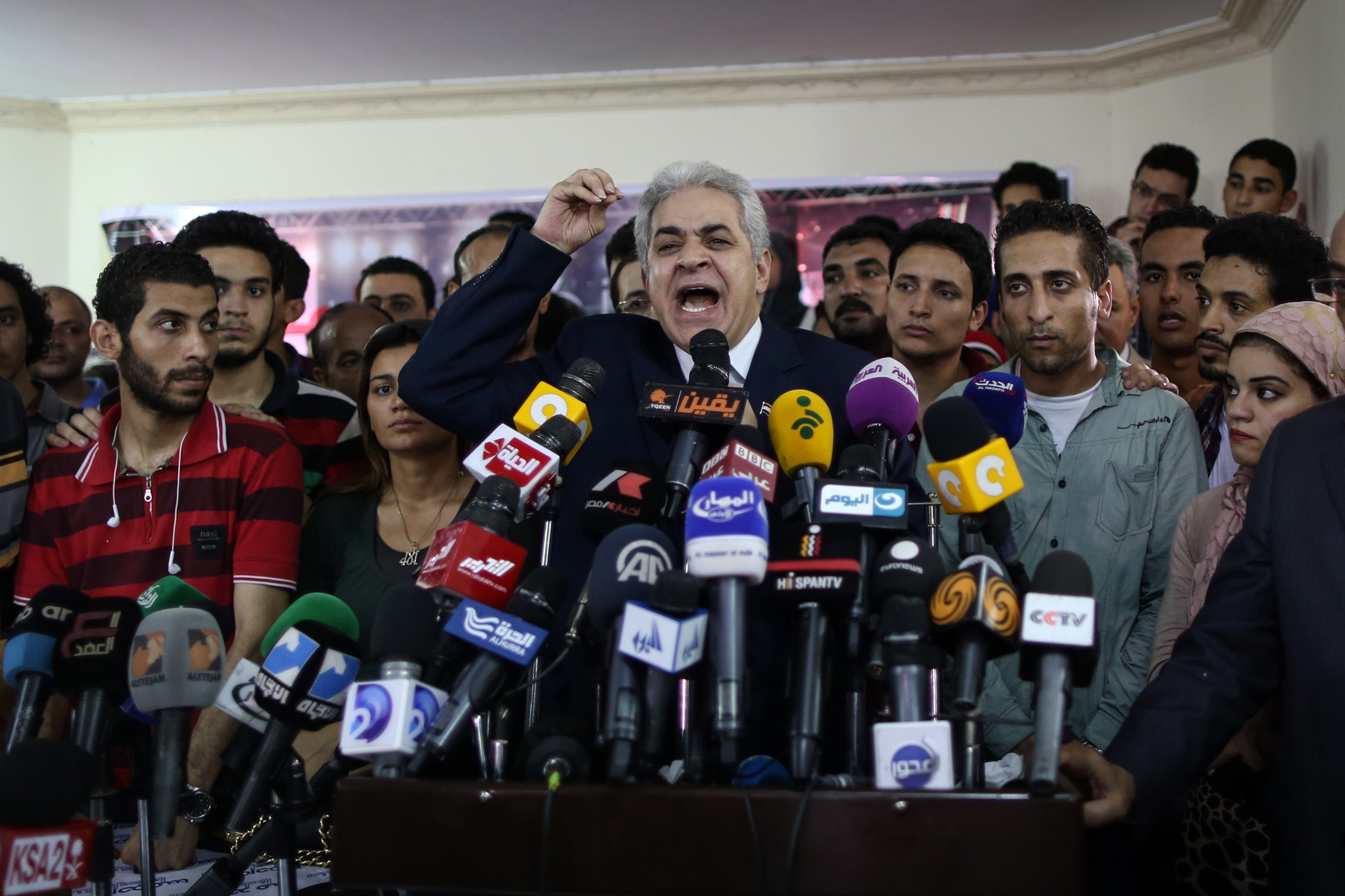 """Egyptian former leftist presidential candidate Hamdeen Sabbahi speaks during a press conference after preliminary results from Egypt's presidential election gave ex-army chief Abdel Fattah al-Sisi 96 percent of the vote on May 29, 2014 in the capital Cairo. Speaking at a news conference, Sabbahi said """"I accept my defeat and respect the people's choice"""" in the three-day election that ended on May 29.     (AFP PHOTO / MOHAMED EL-SHAHED)"""