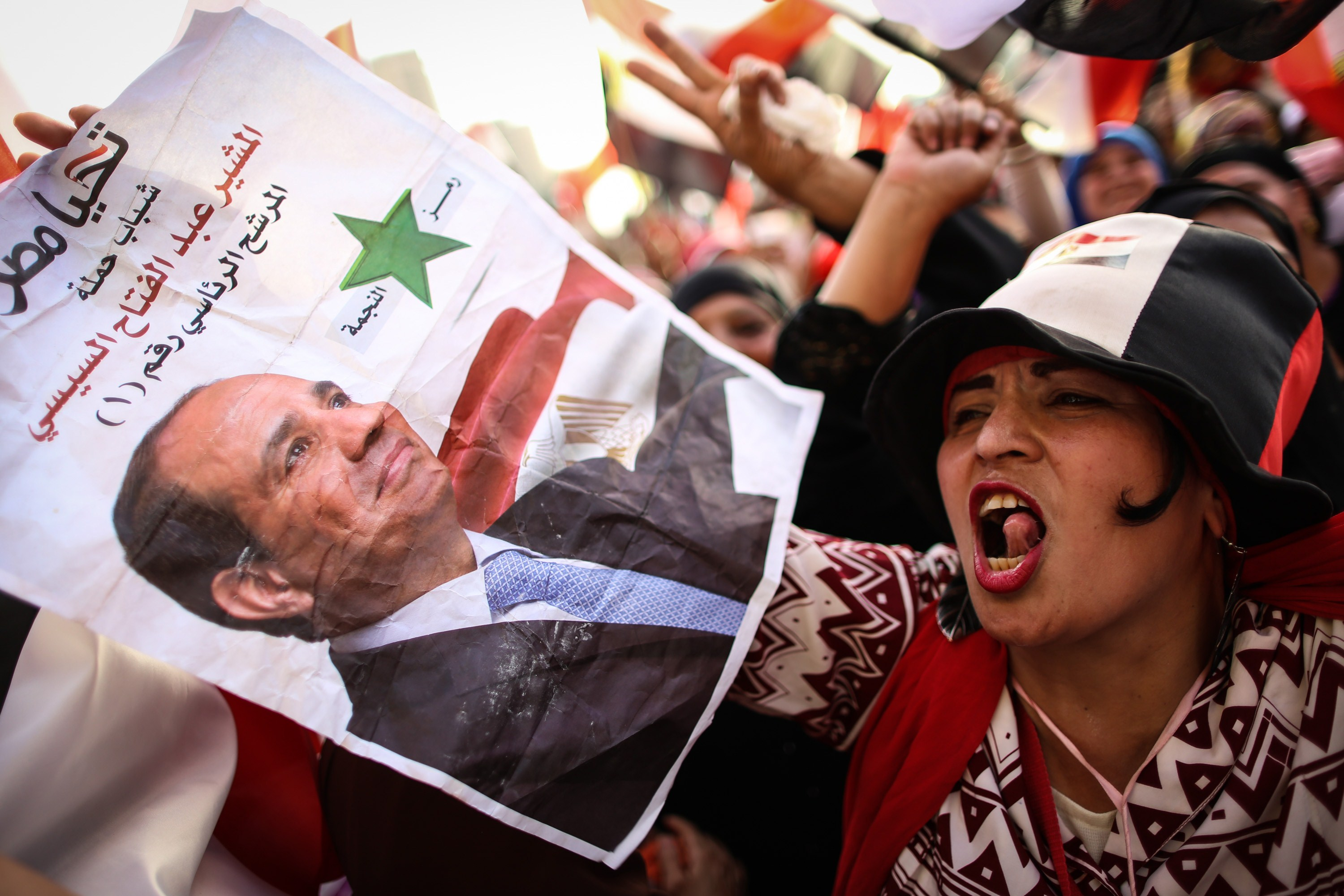 "An Egyptian woman holds a portrait of ex-army chief Abdel Fattah al-Sisi as she celebrates in Cairo's Tahrir Square on June 3, 2014 after Sisi won 96.9 percent of votes in the country's presidential election. Sisi urged his countrymen to work to restore stability and achieve ""freedom"" and ""social justice"", in a speech after he was declared winner of last week's election.  (AFP PHOTO / MOHAMED EL-SHAHED)"