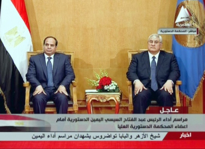 An image grab taken from Egyptian state TV shows ex-army chief and newly elected Egyptian President Abdel Fattah al-Sisi (L) sitting next to interim president Adly Mansour, during Sisi' swearing in ceremony, on June 7, 2014, in Cairo. Ex-army chief Abdel Fattah al-Sisi was sworn in, as Egypt's president, formalising his de facto rule since he deposed the elected Islamist last year and crushed his supporters.