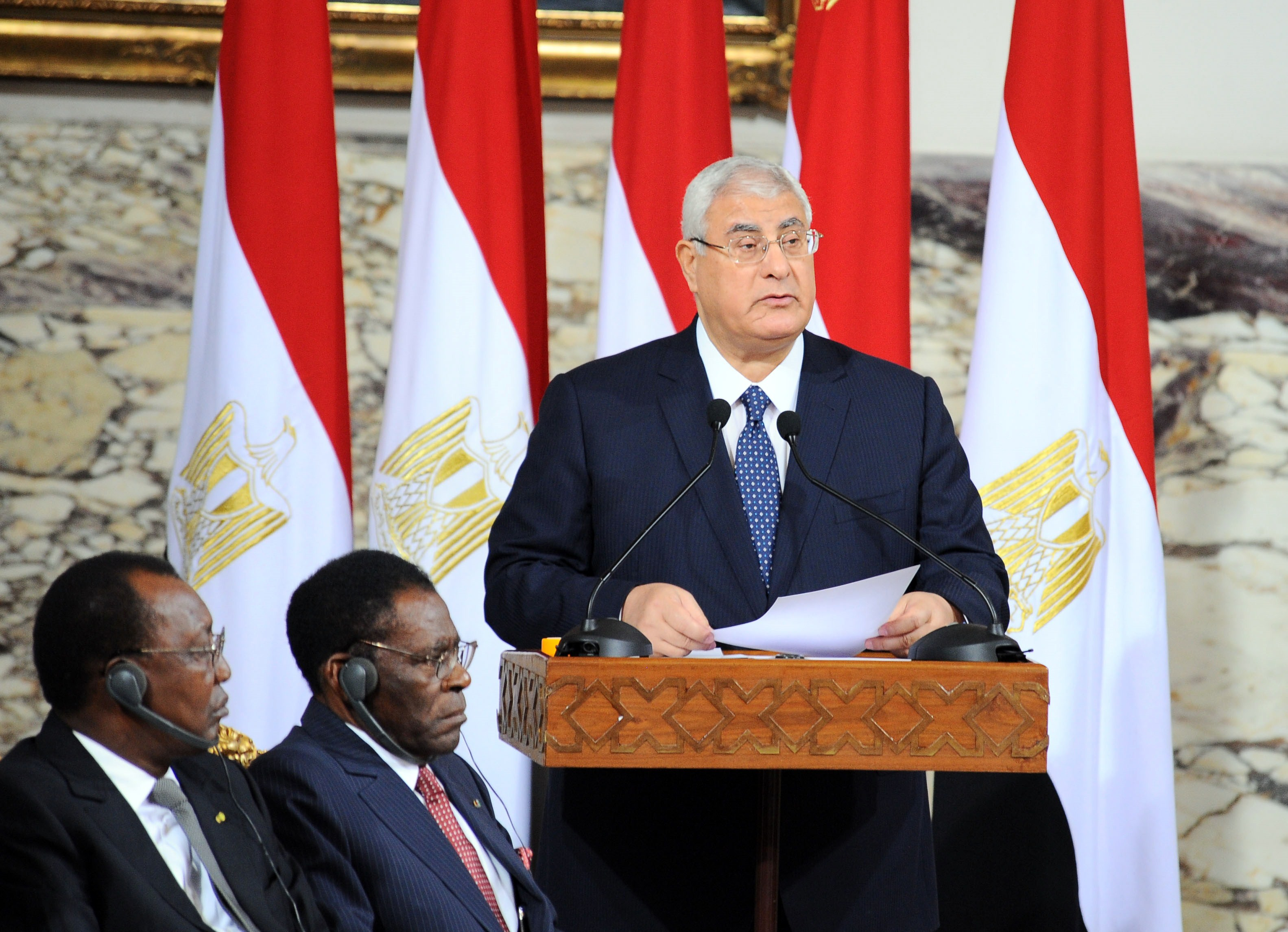 A handout picture made available on June 8, 2014 by the Egyptian presidency shows outgoing interim president Adly Mansour (C) delivering a speech after signing the handing over of power document in Cairo. Former army chief Abdel Fattah al-Sisi was sworn in as Egypt's president, formalising his de facto rule since he deposed the elected Islamist last year and crushed his supporters.   (AFP PHOTO / HO / EGYPTIAN PRESIDENCY)