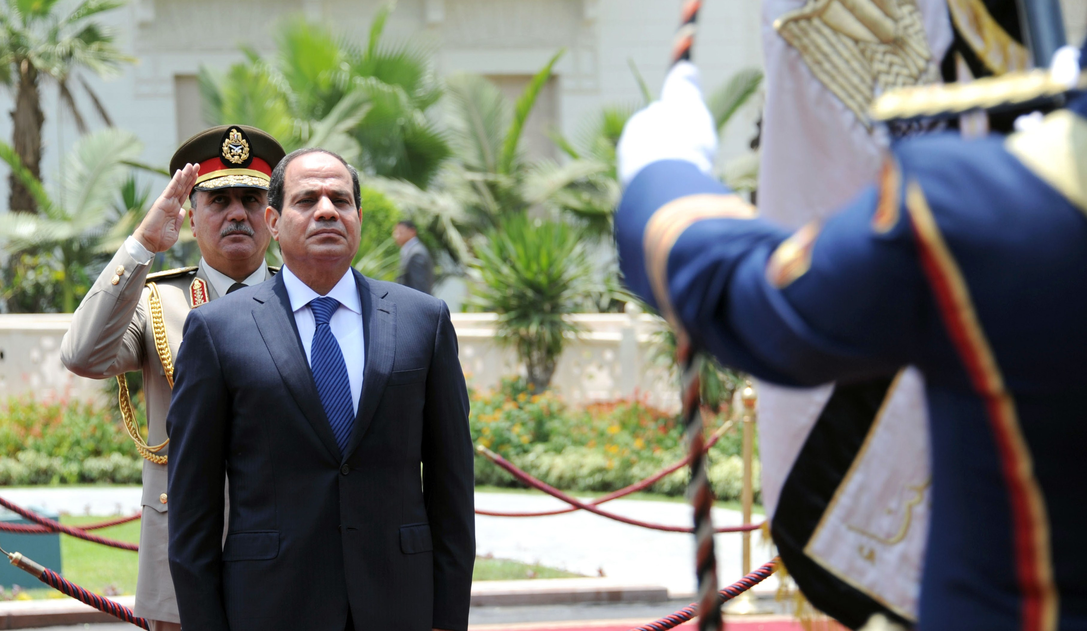 President Abdel Fattah Al-Sisi swore in Egypt's new cabinet early Tuesday morning, to include 14 new ministers and increasing the number of portfolios from 31 to 34. (AFP PHOTO / HO / EGYPTIAN PRESIDENCY)
