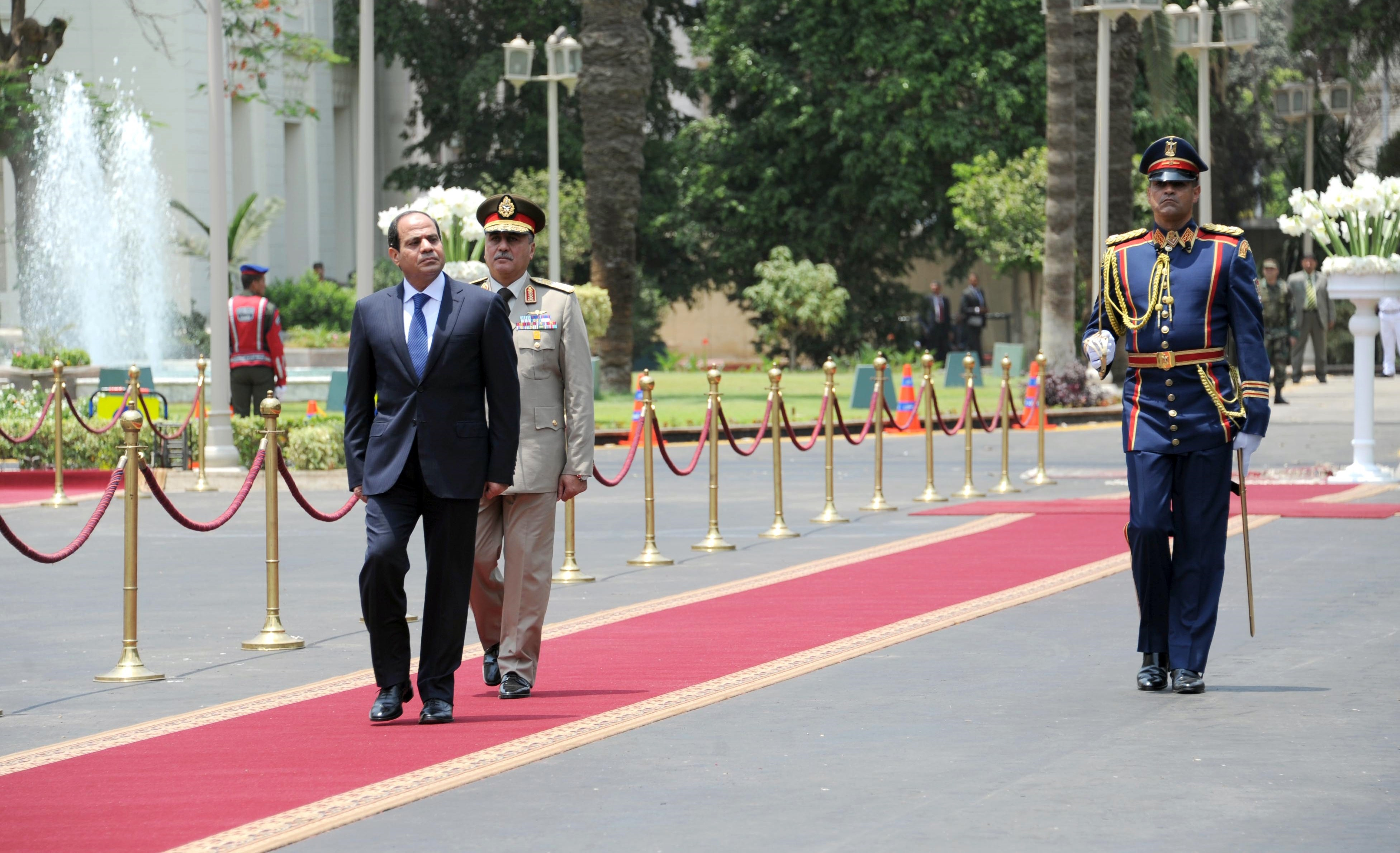 A handout picture made available on June 8, 2014 by the Egyptian presidency shows President elect Abdel Fattah al-Sisi (L) reviewing the honour guard during the handing over of power ceremony in Cairo. Sisi was sworn in as Egypt's president, formalising his de facto rule since he deposed the elected Islamist last year and crushed his supporters.   (AFP PHOTO / HO / EGYPTIAN PRESIDENCY)