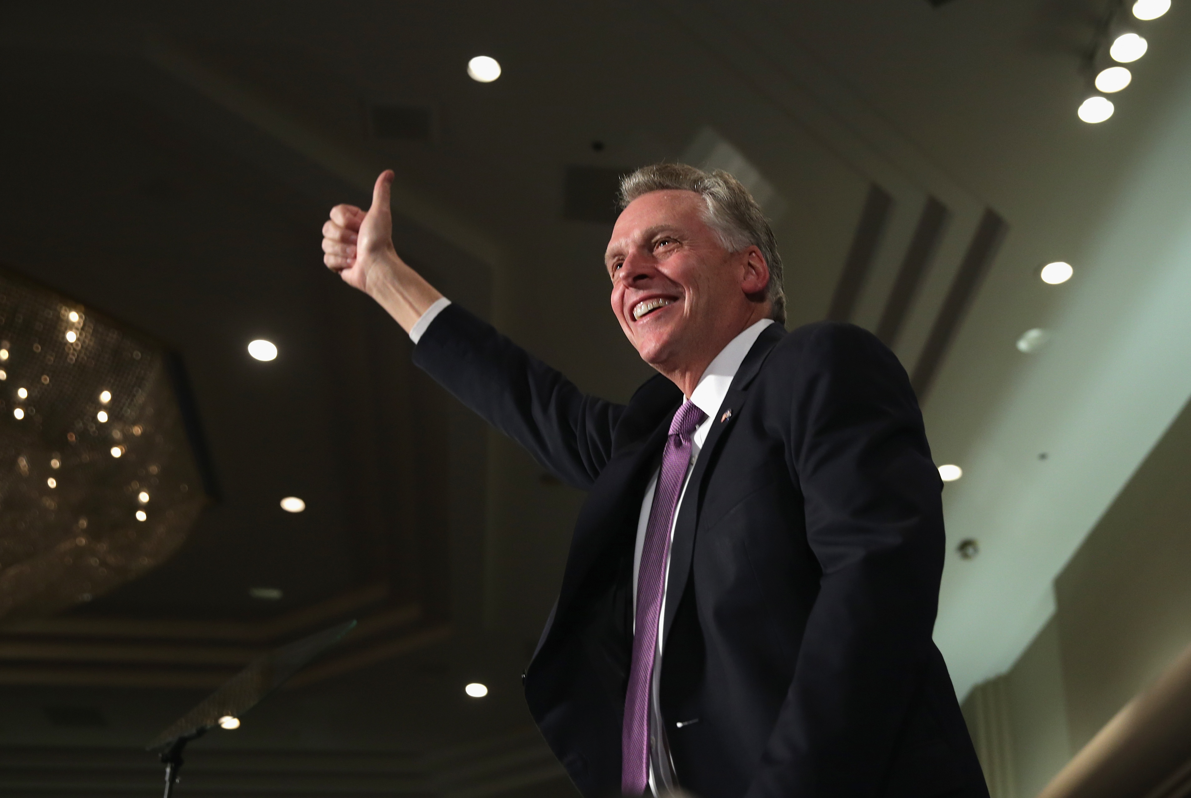 Democrat Terry McAuliffe celebrates winning the Virginia governorship at an election-night party at the Sheraton Premiere Hotel November 5, 2013 in Tysons Corner, Virginia. McAuliffe defeated Republican state Attorney General Ken Cuccinelli.  (Alex Wong/Getty Images/AFP)