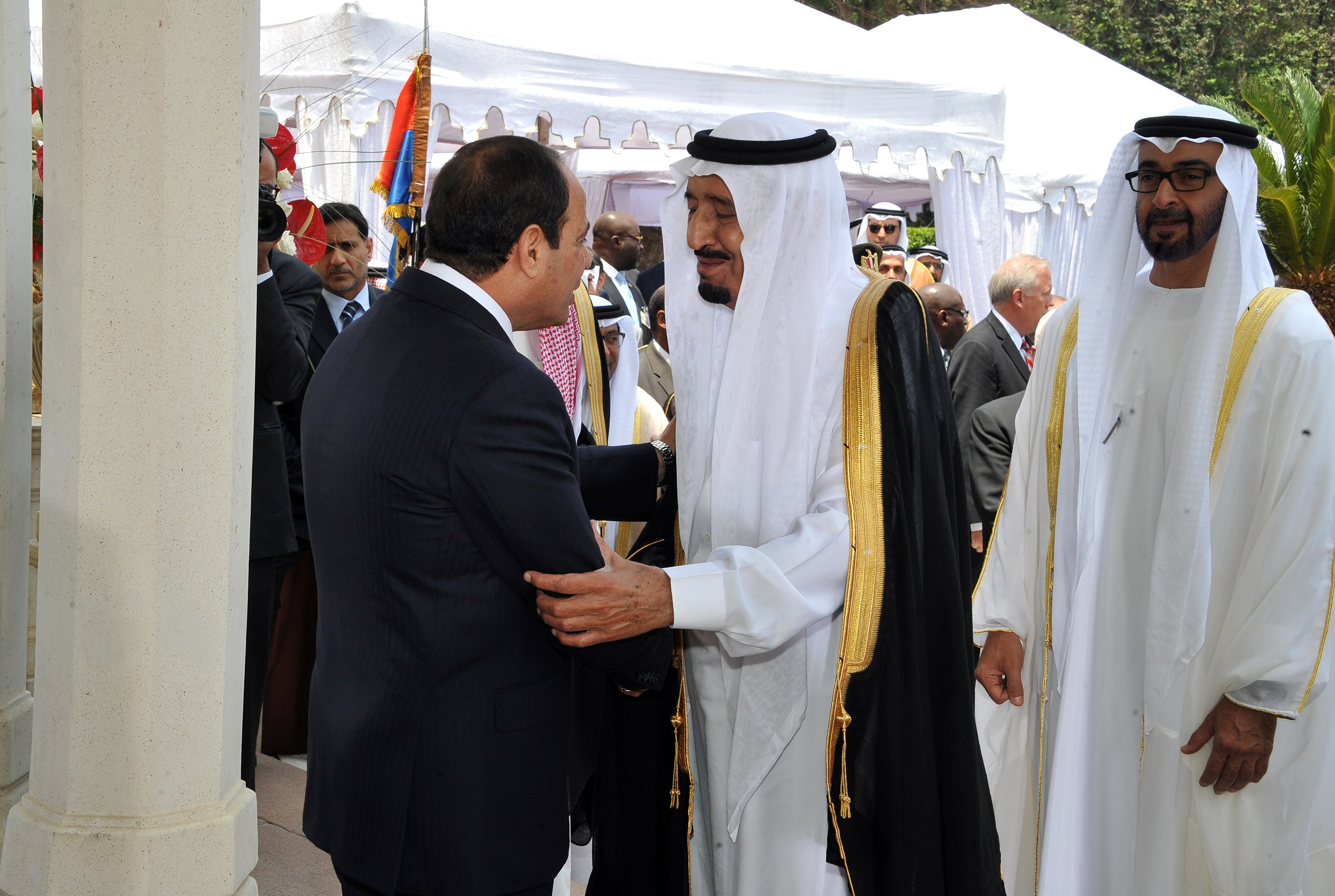 A handout picture made available on June 8, 2014 by the Egyptian presidency shows President elect Abdel Fattah al-Sisi (L) receiving congratulations from Saudi Arabia's Crown Prince Salman bin Abdul Aziz (C) and Crown Prince of Abu Dhabi Mohammed bin Zayed al-Nahayan (R) following his assumption of power in Cairo. Sisi was sworn in as Egypt's president, formalising his de facto rule since he deposed the elected Islamist last year and crushed his supporters.  (AFP PHOTO / HO / EGYPTIAN PRESIDENCY)