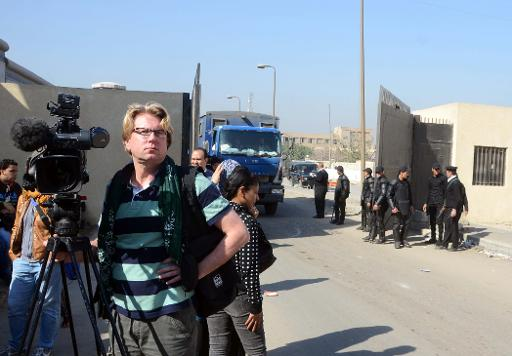 Foreign journalists wait outside Cairo's Tora prison where Al-Jazeera journalists are being held before their trial (AFP, Hossam Bakir)