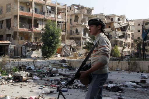 A Syrian rebel patrols the streets of Aleppo, on November 17, 2013  (AFP, Karam al-Masri)