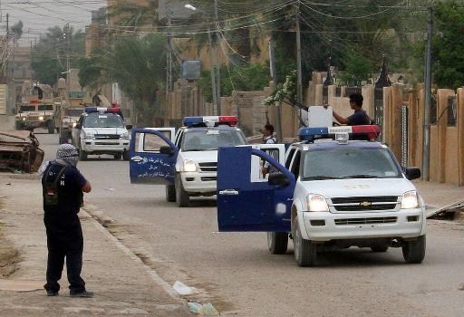 Iraqi police patrol the streets of Fallujah, on May 16, 2007  (AFP/File, Paul Schemm)
