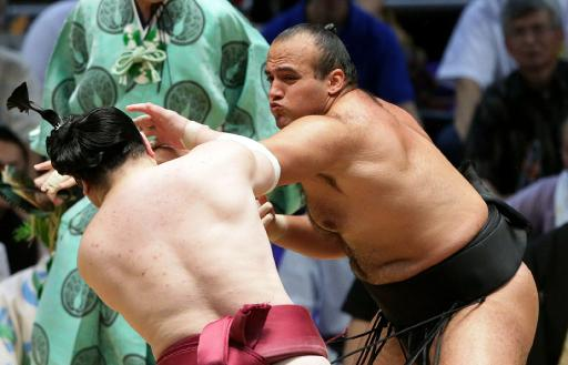 Egyptian sumo wrestler Abdelrahman Ahmed Shaalan (right) pushes Oniarashi out of the ring during the 15-day Nagoya Grand Sumo Tournament in Nagoya in Aichi prefecture, central Japan on July 7, 2013 (Jiji Press/AFP/File)