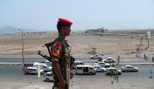 Yemeni security forces secure a main road in the southern port of Aden, on March 28, 2012  (AFP/File)