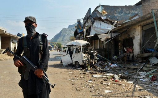 A Pakistani policeman stands guard at the site of a suicide bomb attack in Darra Adam Khel on October 13, 2012 (AFP/File, A. Majeed)