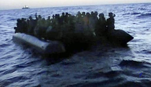 Screen grab from a video released by the Italian Navy on October 13, 2013 shows immigrants aboard a raft before being rescued off the Italian island of Lampedusa (Italian Navy/AFP/File)