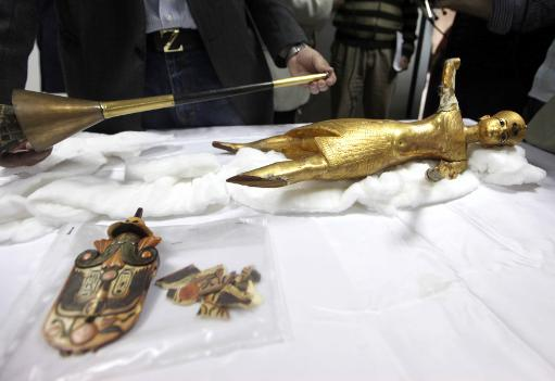 Artefacts and a golden statuette of King Tutankhamun that were stolen from the Egyptian Museum, then recovered, seen on April 12, 2011 in Cairo  (AFP/File, Str)