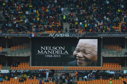 People attend the memorial service of South African former president Nelson Mandela at the FNB Stadium (Soccer City) in Johannesburg on December 10, 2013 (AFP, Odd Andersen)