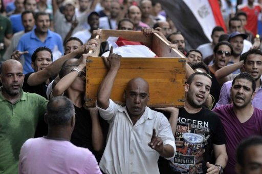 Egyptian people carry the coffin of a victim of the clashes that broke out on July 6, 2013 in al-Manial (AFP, Mohamed el-Shahed)