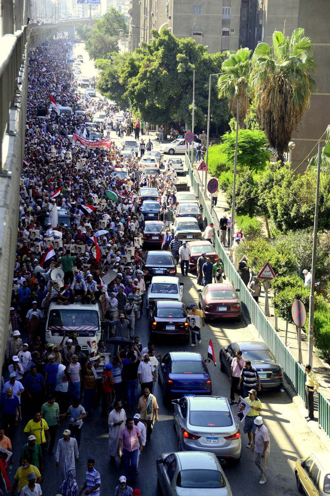 Morsi supporters march from Ramses Square to Rabaa sit in (Photo by Aaron T Rose)