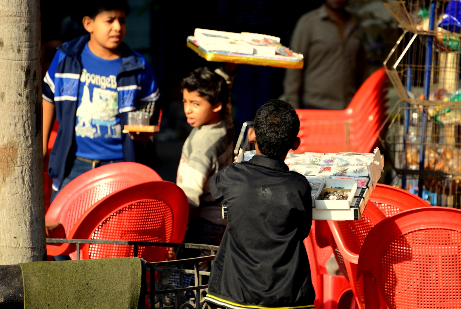 Street boys selling trays of tissue packets in Downtown Cairo (Photo by Aaron T. Rose)
