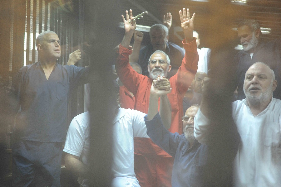 Muslim Brotherhood Supreme Guide Mohamed Badie and FJP leader Essam Al-Arian during Saturday's trial session where scores of Muslim Brotherhood leaders were sentences to death.  (Photo by Ahmed Al-Malky)