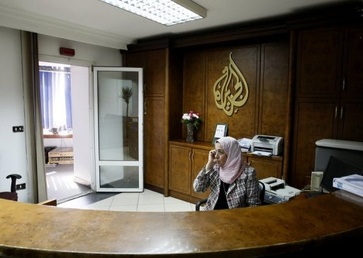 An Al-Jazeera employee talks on the phone at the pan-Arab television channel's bureau in Cairo on January 30, 2011 (AFP/File, Mohammed Abed)