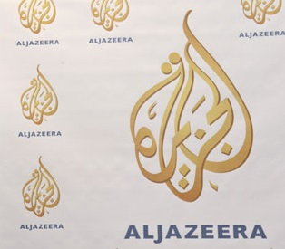 Three foreign Al Jazeera journalists were released and deported on Sunday after being held without charge since 27 August. (AFP Photo)