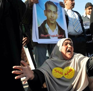 Relatives of the victims of the Al-Salam Boccaccio 98 ferry sinking react in outside a court in Hurghada on March 11, 2009, after the owner Mamduh Ismail to seven years in jail. The Al-Salam sank in the middle of the Red Sea on February 3, 2006 killing more than 1,000 people in one of the deadliest disasters in modern maritime history. The verdict was greeted with cheers from victims' families, who had reacted with outrage when Ismail and a string of other defendants were cleared over the tragedy in a trial in June 2008.  (AFP FILE PHOTO/MOHAMED AHMED)