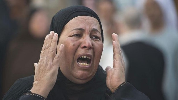 An Egyptian woman outside court in Minya after 683 alleged Islamists were sentenced to death.  (AFP Photo)