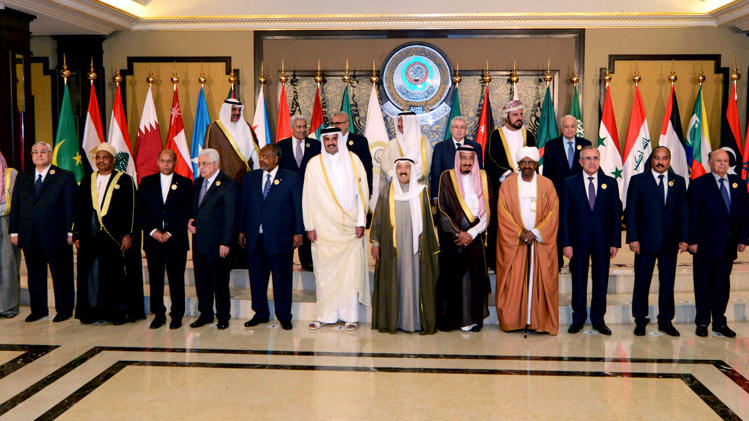 Arab leaders pose for a group photograph during the opening session of the Arab League Summit