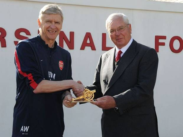 Arsenal chairman Sir Chips Keswick and football team maneger Arsene Wenger celebrating one of Arsenal trophies