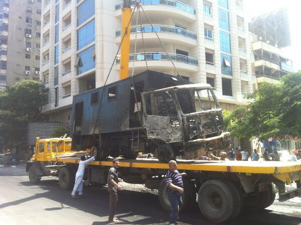 Police truck lifted away, Batal Ahmed Abdel Aziz st.  Charlie Miller