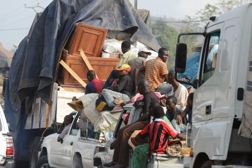 A convoy of lorries and taxis packed with Muslims fleeing Christian vigilantes heads north from Bangui on February 7, 2014  (AFP, Issouf Sanogo)