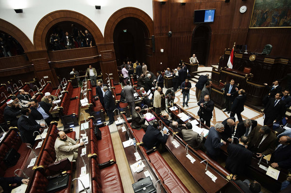 Members of Egypt's constituent assembly discuss the last voting session on a new draft constitution at the Shoura Assembly on November 29, 2012 in Cairo (AFP File Photo)