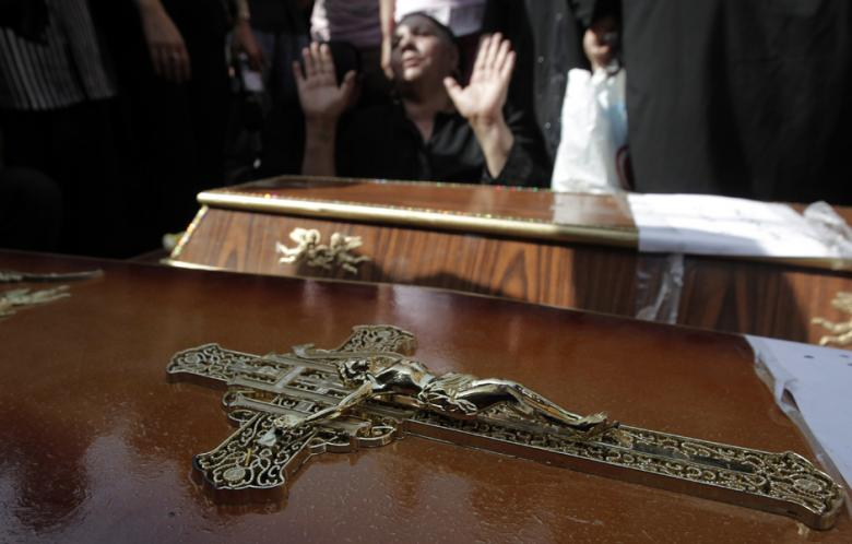 An Egyptian woman mourns over the coffins of some of the 24 Coptic Christians killed during over night clashes with Egyptian security forces on 10 October 2011.  (AFP File Photo\ Mahmud Hams)