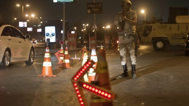 Troops keep watch at a checkpoint during the curfew hours in Cairo late on August 19. Egypt is to shorten a night-time curfew imposed on Cairo and 13 provinces starting Saturday, the cabinet said on Thursday. (AFP/File)